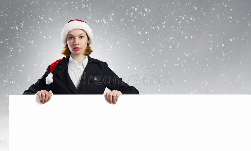 有横幅的圣诞老人妇女 免版税库存图片