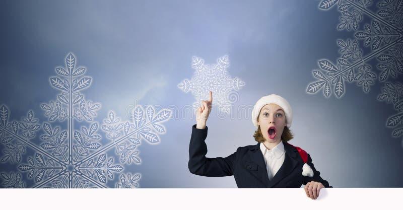 有横幅的圣诞老人妇女 库存图片