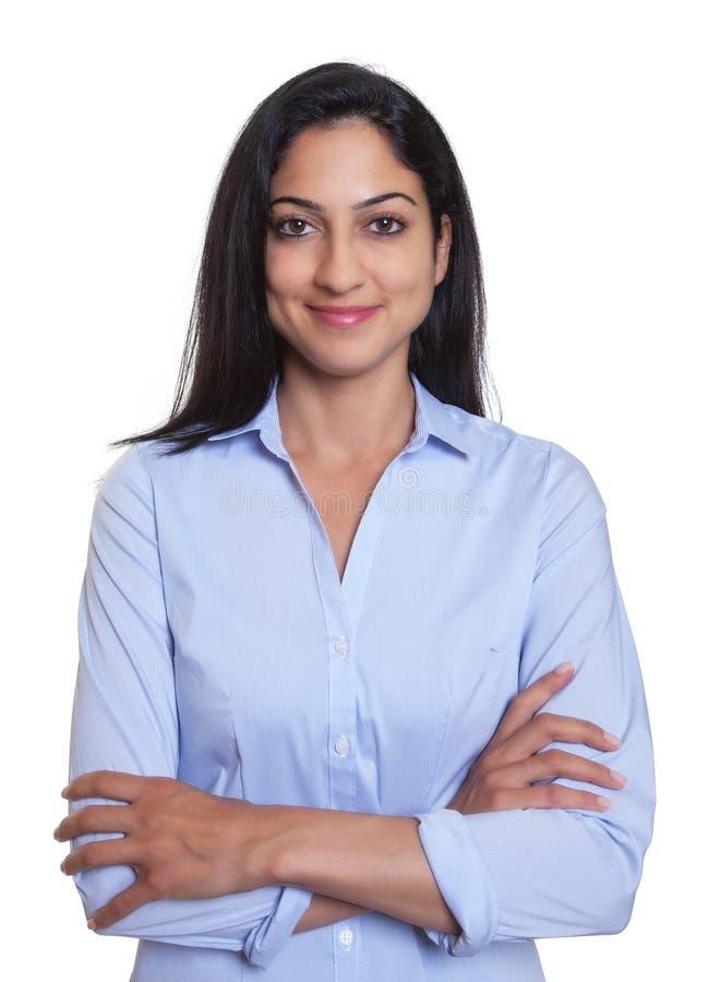 有横渡的胳膊的可爱的土耳其女实业家 库存图片