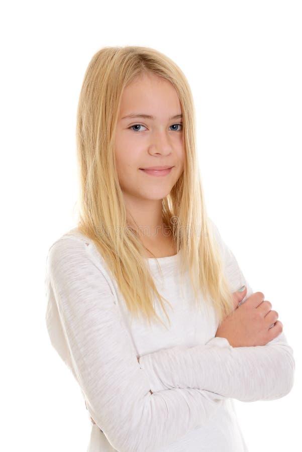 有横渡的胳膊的好白肤金发的女孩 免版税库存图片