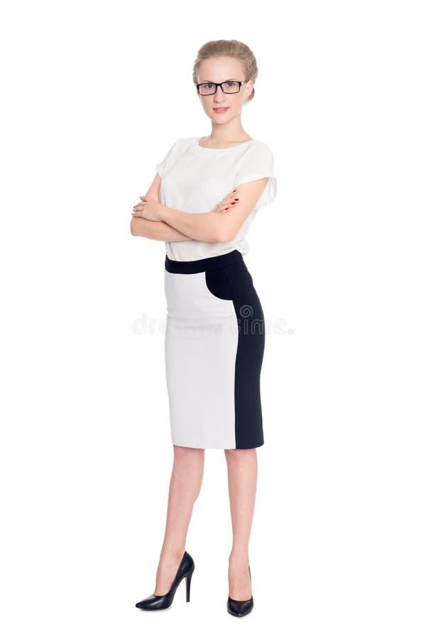 有横渡的胳膊的年轻成功的企业夫人 免版税库存照片