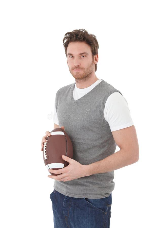 有橄榄球球的大学生 免版税库存照片