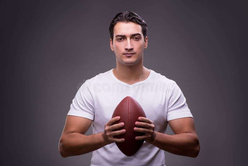 有橄榄球的人在体育概念 免版税库存图片