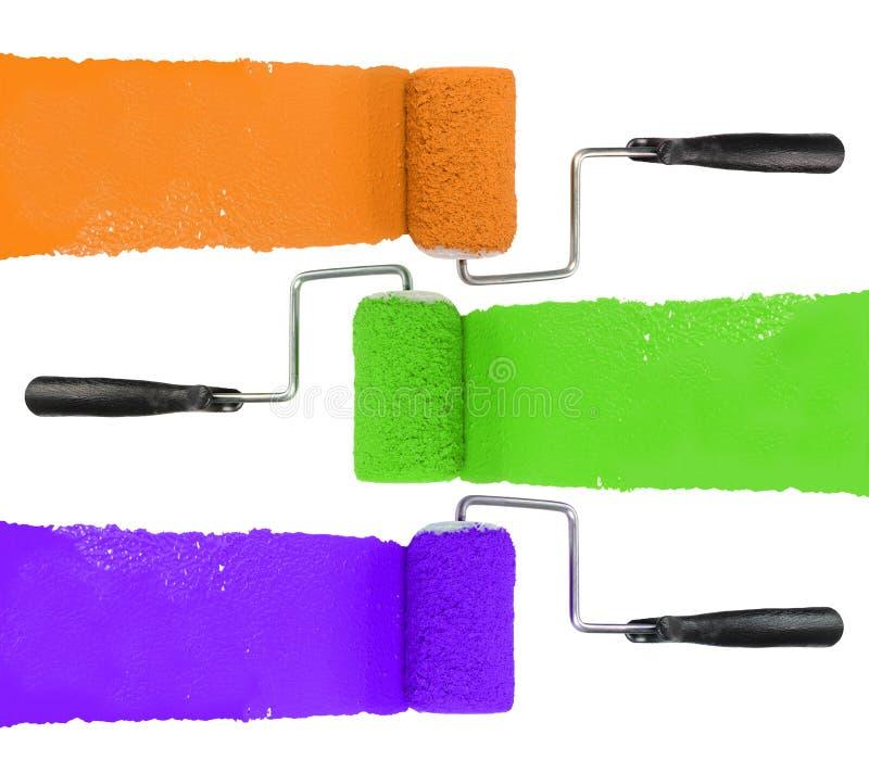 有橙色绿色的漆滚筒和紫色 免版税库存图片