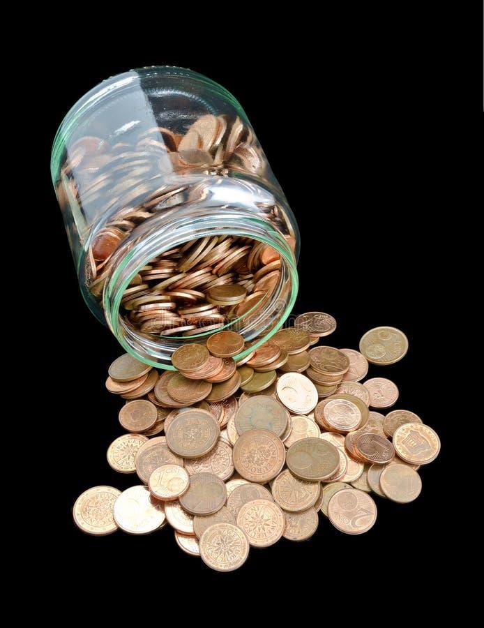有欧洲分硬币的瓶子 图库摄影