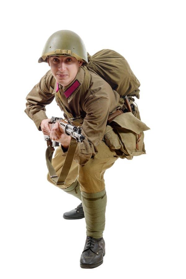 有步枪的年轻苏联战士在白色背景 库存图片