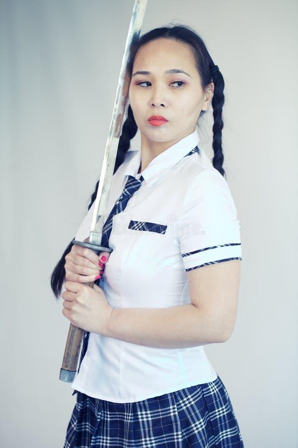 有武士剑的学校女孩 库存照片