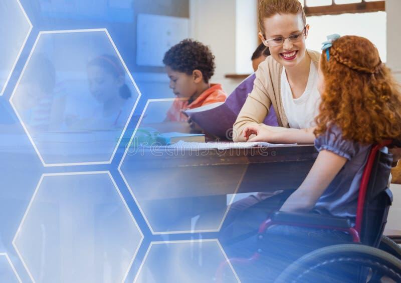 有残疾学生的学校教师在类的轮椅的 图库摄影