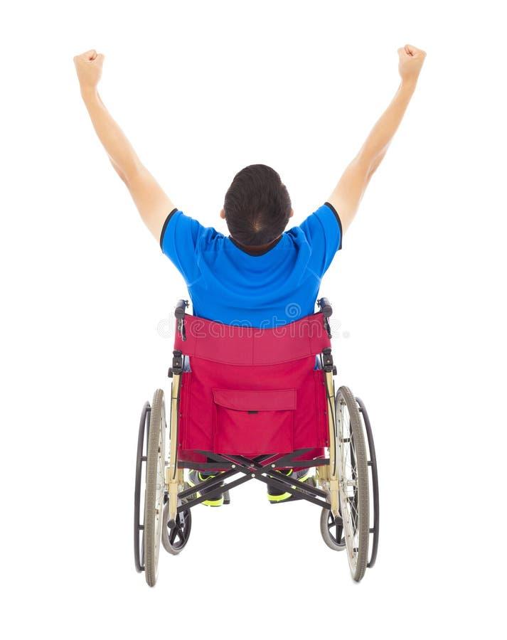有残障的人坐轮椅和培养胳膊 图库摄影