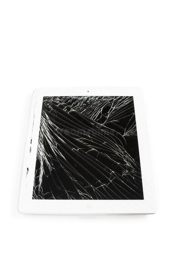 有残破的玻璃屏幕的片剂计算机 库存照片