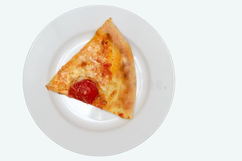 有比萨饼的板材在白色的隔绝了背景 免版税库存图片