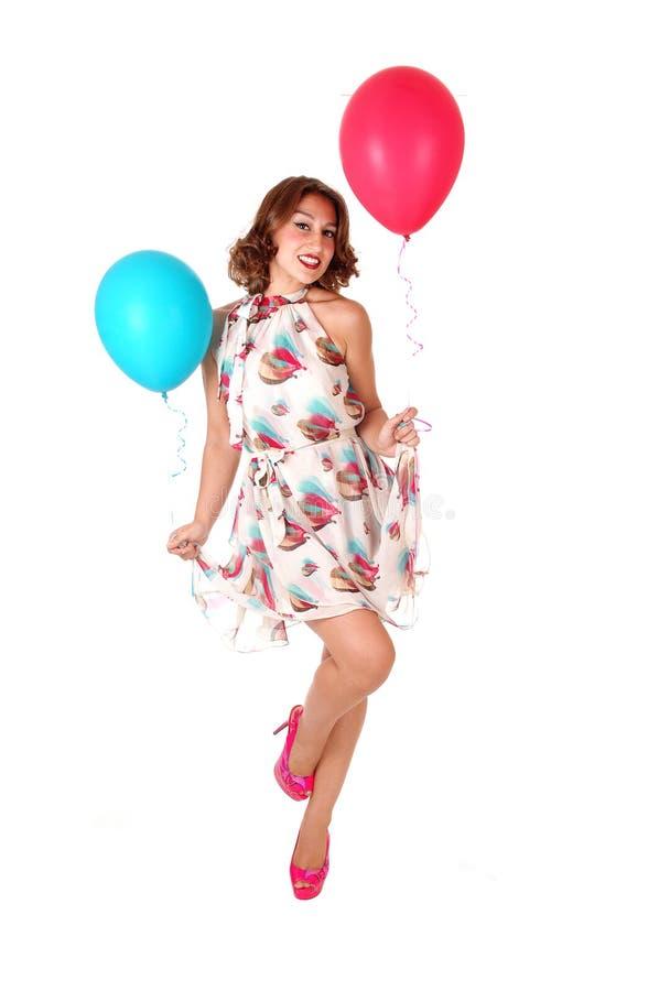 有气球的可爱的跳舞妇女 库存照片