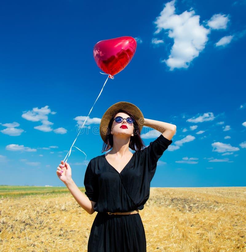 有气球的少妇 免版税图库摄影