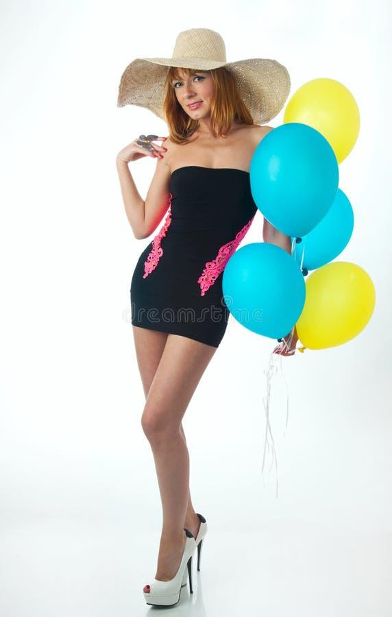 有气球的美丽的妇女 库存照片