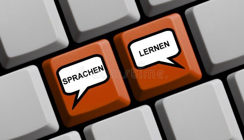 有气球的键盘学会德语的语言 库存照片