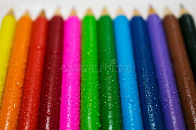 有水下落的色的木铅笔 艺术、创造性和dra 免版税库存图片