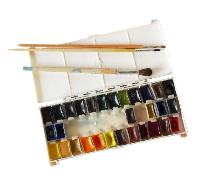 有水彩油漆和刷子的开放箱子 库存图片