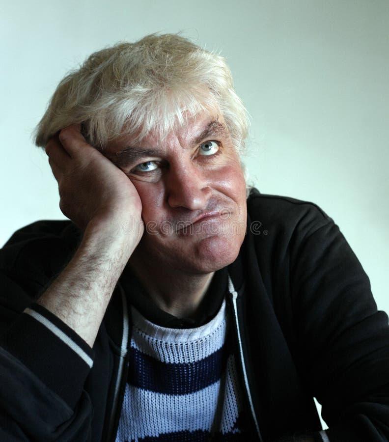 有沉思面孔的50岁的人 库存图片