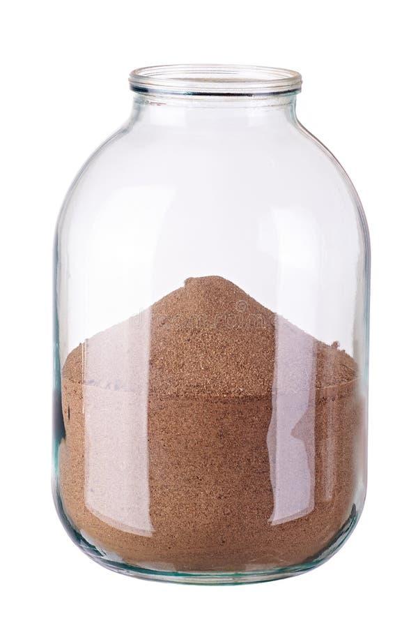 有沙子的玻璃瓶子在白色背景 库存照片
