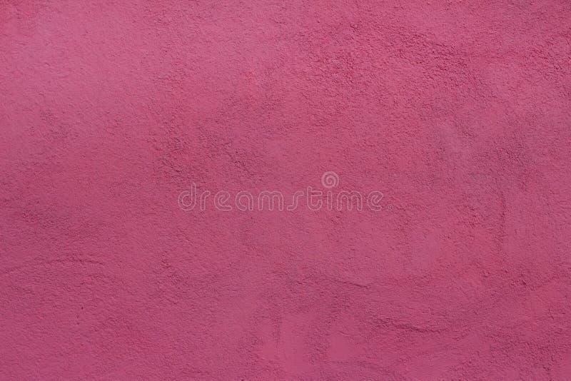 有油灰桃红色被绘的纹理的背景墙壁 库存照片