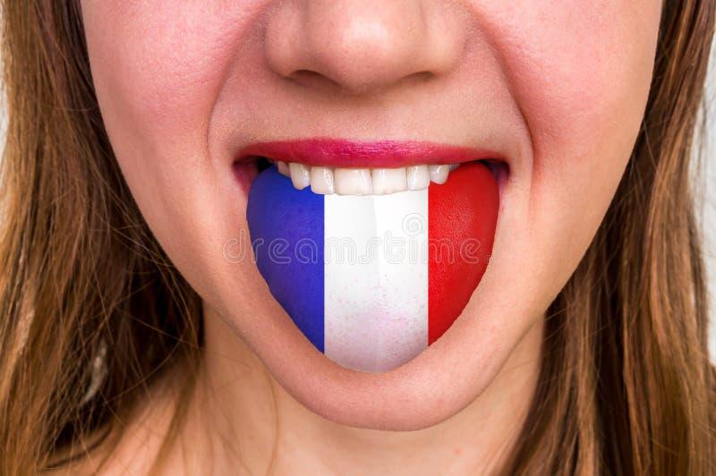 有法国旗子的妇女在舌头 免版税库存照片
