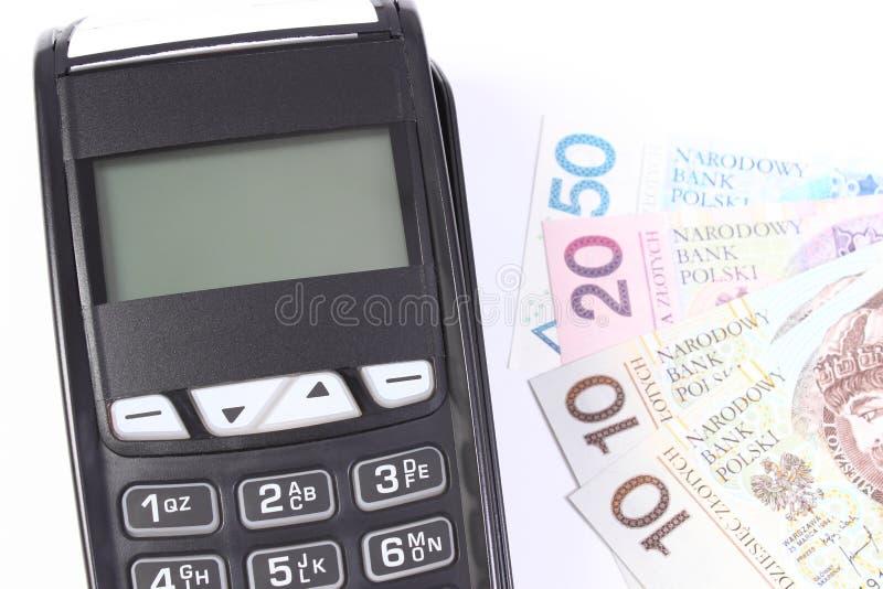 有波兰货币金钱的付款终端在白色背景,支付购物,财务概念 库存图片