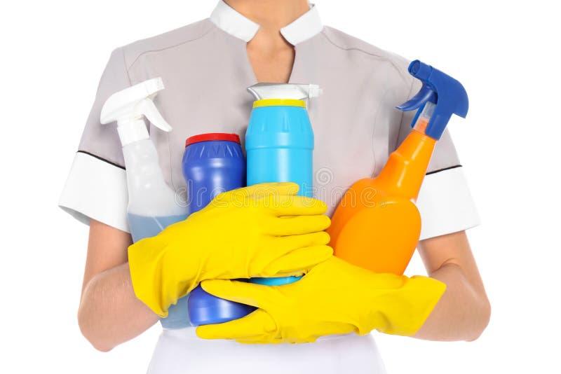 有洗涤剂的年轻女服务生 免版税图库摄影