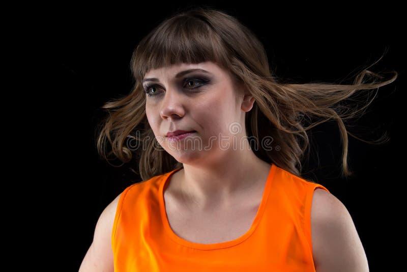 有流动的头发的图象妇女,看  免版税库存照片