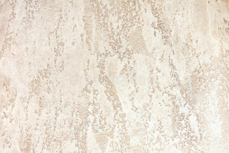 有浅褐色的颜色装饰膏药的墙壁 被构造的背景 库存照片
