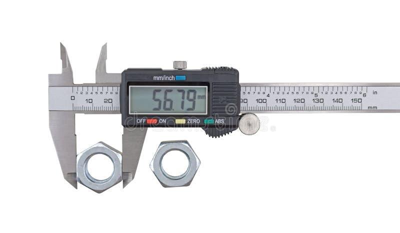 有游标卡尺的测量的大钢坚果 免版税库存照片