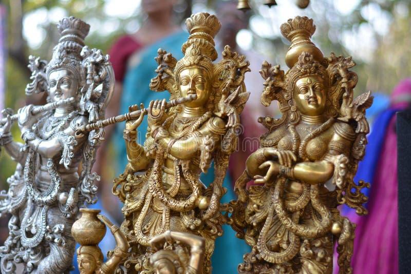 有演奏长笛的女性女神的印度神克里希纳 库存照片
