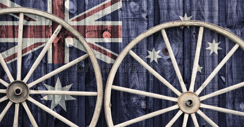 有澳大利亚旗子的古色古香的马车车轮 免版税库存图片