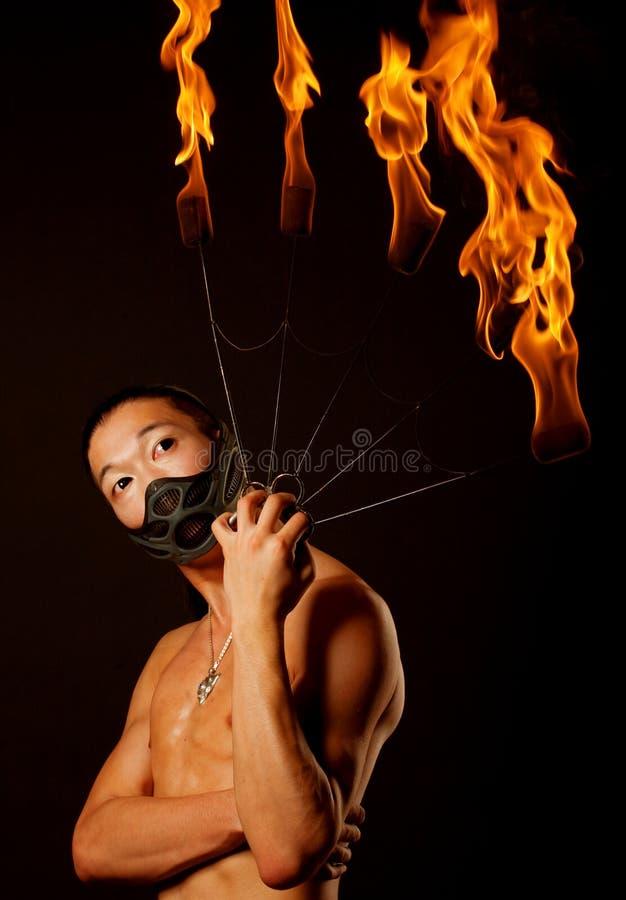 有火显示的亚裔人 库存图片