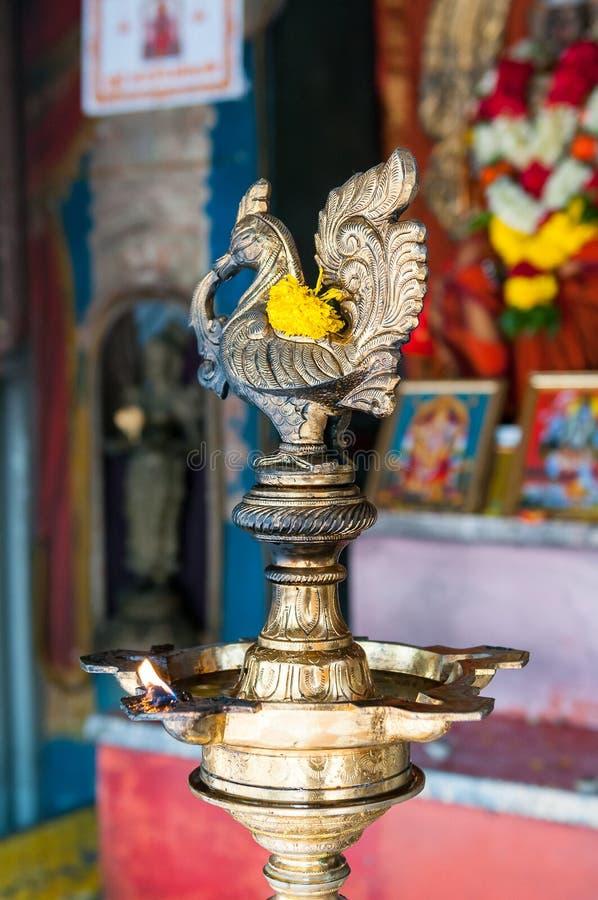 有火焰的寺庙灯 免版税库存图片