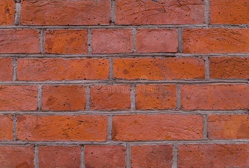 有灰色水泥线的红色砖墙阻拦难看的东西背景 库存照片