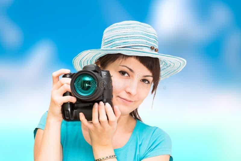 有照相机的妇女摄影师 库存照片