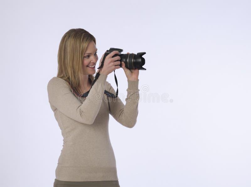 有照相机的摄影师在演播室 库存照片