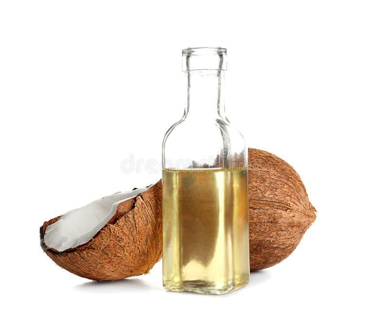 有熔化椰子油和坚果的瓶 库存照片