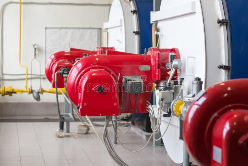 有燃气锅炉的煤气喷燃器 库存照片