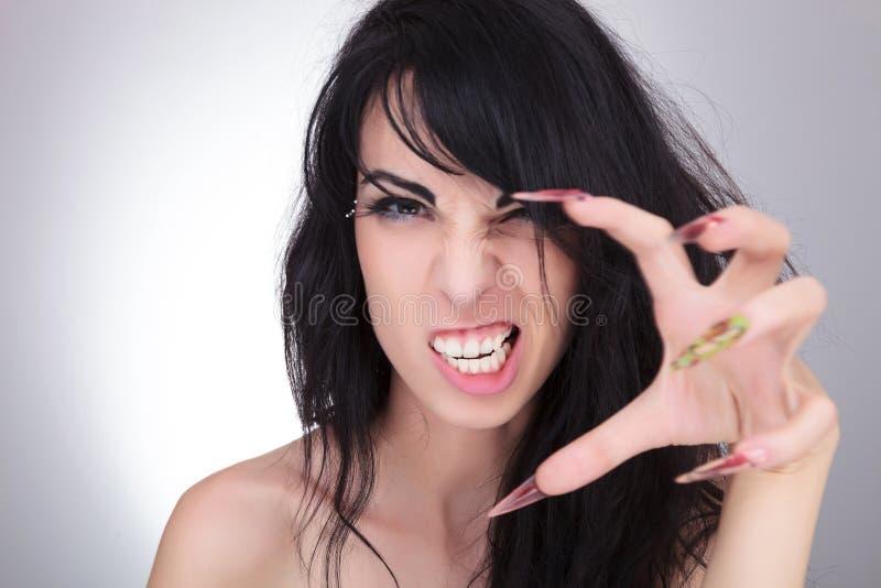 有爪的时尚妇女 免版税库存图片
