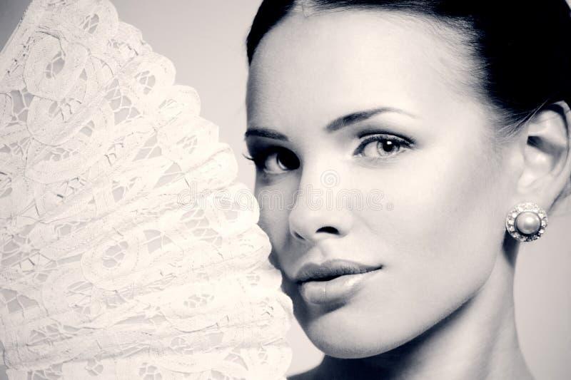 有爱好者的美丽的妇女 图库摄影