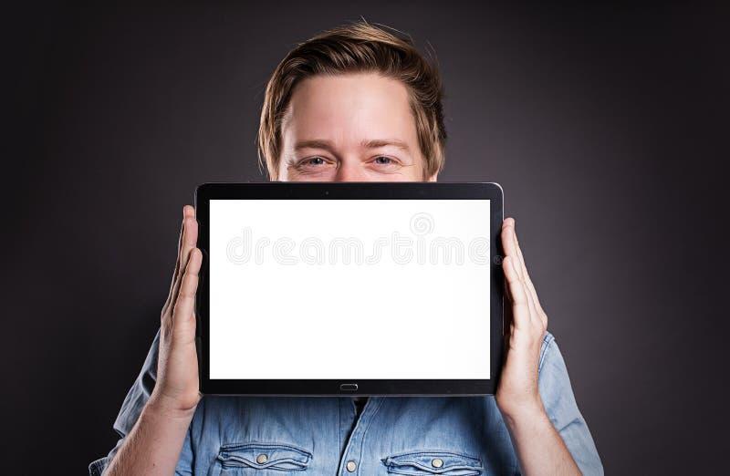 有片剂个人计算机的人 图库摄影