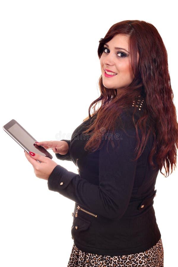 有片剂个人计算机的愉快的女孩 免版税库存照片