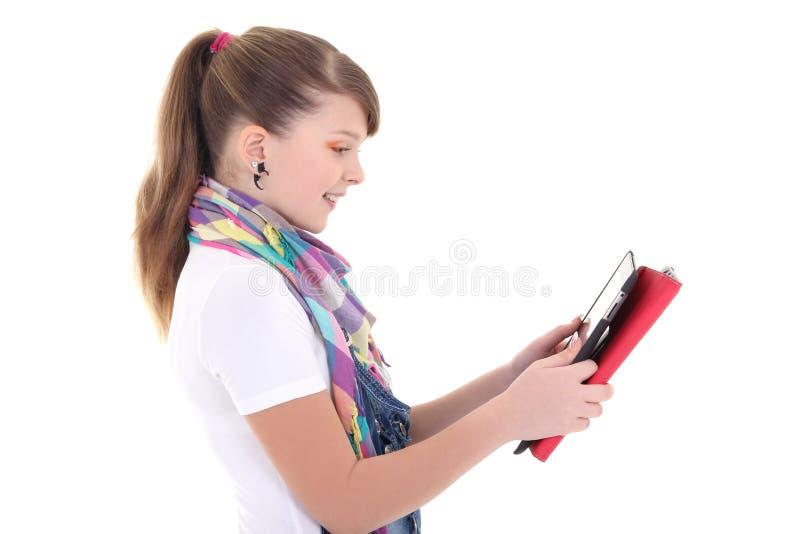 有片剂个人计算机的美丽的十几岁的女孩 图库摄影