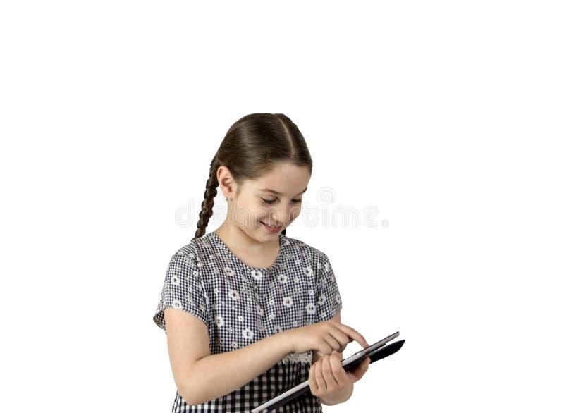 有片剂的女孩 免版税库存图片