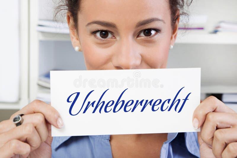 有版权的妇女签到蓝色 免版税库存照片