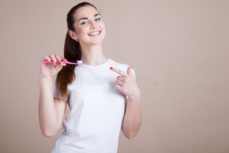 有牙刷的女孩 库存图片