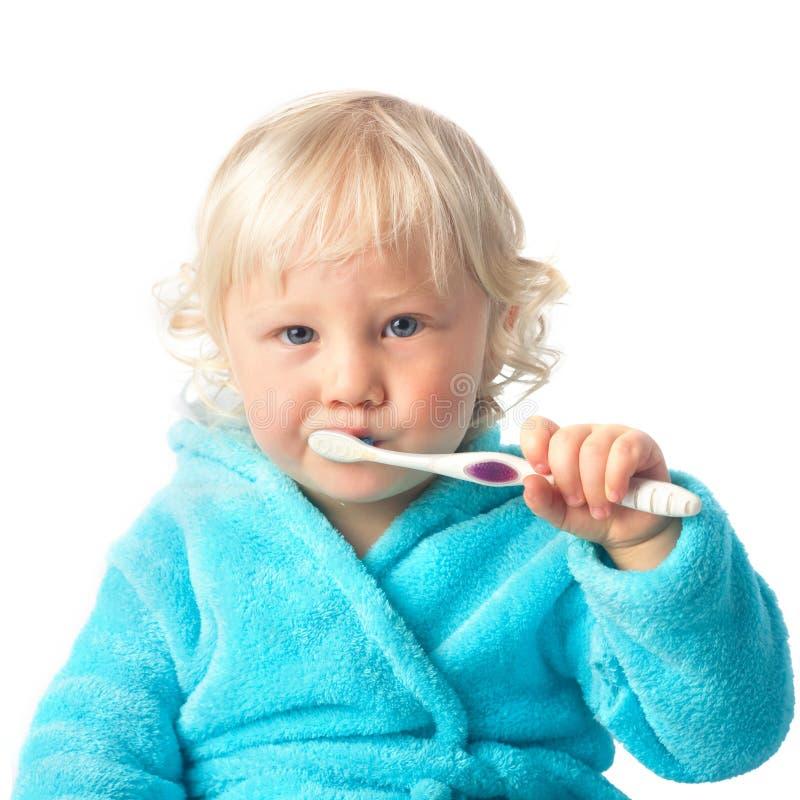 有牙刷的逗人喜爱的男婴 库存图片
