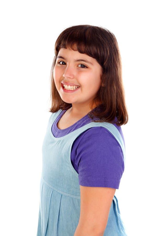有牛仔布衣裳的美丽的深色的女孩 图库摄影