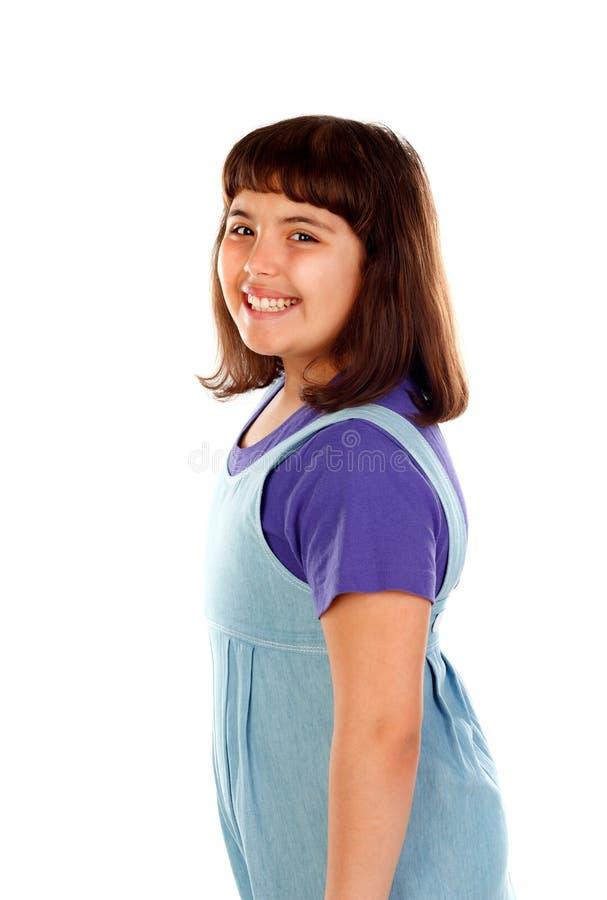 有牛仔布衣裳的美丽的深色的女孩 库存图片